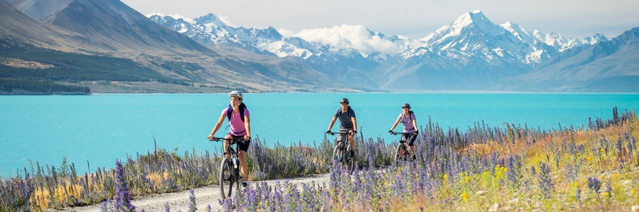 Cycling alongside Lake Pukaki
